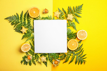 Wall Mural - Summer composition with fresh tropical leaves, blank card and fruits on color background