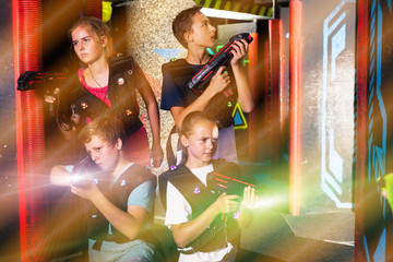Happy teenagers with laser guns