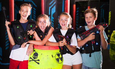Girls and boys posing with laser pistols