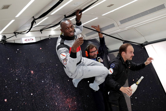 Retired sprinter Usain Bolt and French Interior designer Octave de Gaulle enjoy zero gravity conditions during a flight in a specially modified plane above Reims