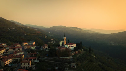 Aerial view of a typical small village in the Italian hills at sunset.