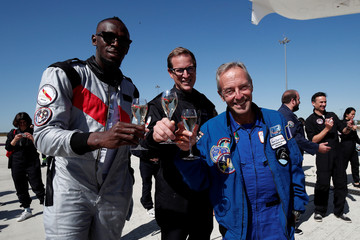Retired sprinter Usain Bolt, French astronaut Jean-Francois Clervoy, CEO of Novespace, and Quentin Meurisse from Martell Mumm Perrier-Jou't after they enjoyed zero gravity conditions during a flight in a specially modified Airbus Zero-G plane above Reims