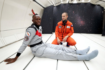 Retired sprinter Usain Bolt poses inside a specially modified Airbus Zero-G plane before a zero gravity conditions flight above Reims