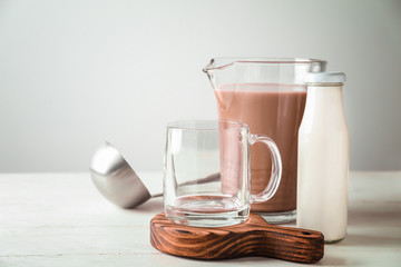 Composition with tasty cocoa on white table