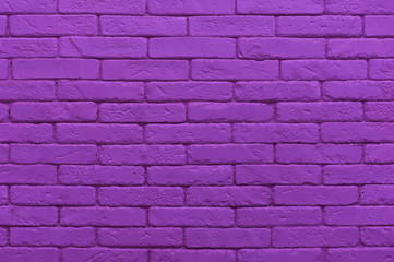 ultraviolet brick wall painted at saturated purple colour