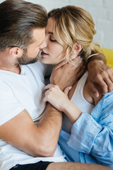 close-up view of passionate young couple in love kissing at home