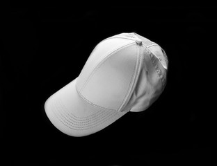 White baseball cap on black background. Template for placing your design.