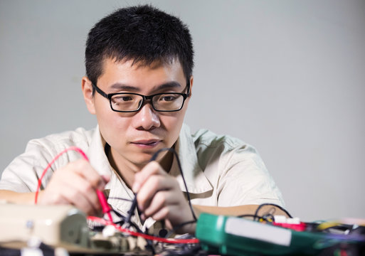 Engineer is welding electronic circuit