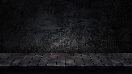 Empty wooden tabletop isolated on dark background. For your product placement or montage with focus to the table top in the foreground. Empty dark wooden shelf