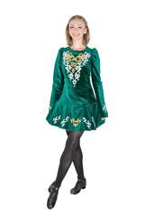 Beautiful young woman in Irish dance green dress isolated