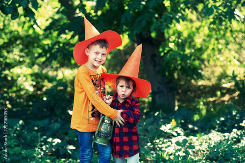 funny kids in hats for halloween outdoors the day of the feast of halloween