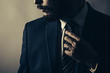 Beard man wearing a blue suit