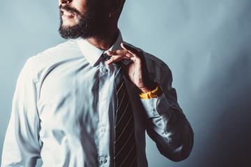 Corporate beard man releases tight tie