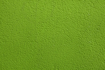 Green painted stucco wall.