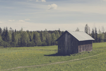 Old barn in the field. Image has a vintage effect applied.