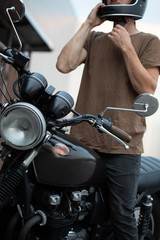biker guy isits on classic style motorcycle