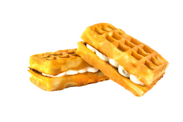 Soft waffles with a filling. Two waffles with a cream filling on a white background.