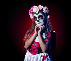 Girl in  Halloween santa muerte outfit low key portrait