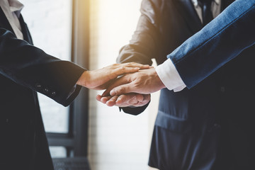 Image of business people joining and putting hands together during their meeting, connection and collaboration concept, Teamwork process of partner and best relationship