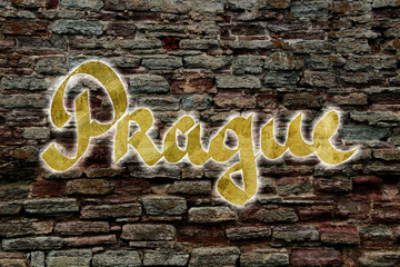 Prague logo of neon tubes on a brick wall