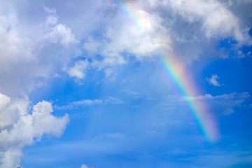 Fototapete - real rainbow on blue sky with clouds nature background.