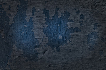 mysterious texture of a blue concrete wall with a peeled paint layer