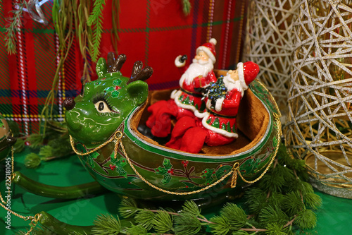 Two Santa Claus Riding Green Reindeer Shaped Sleigh A Unique Christmas Home Decoration