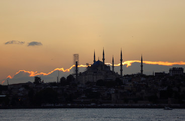 The sun sets over the Sultanahmet mosque, also known as the Blue Mosque, and the old city in Istanbul