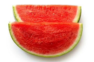 Two slices of seedless watermelon isolated on white from above.