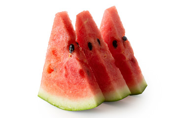 Three standing watermelon triangles with seeds  isolated on white.