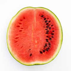 Half watermelon with seeds  isolated on white from above.