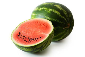 Half watermelon with seeds next to whole watermelon isolated on white.