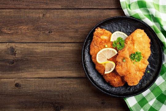 Homemade breaded german weiner schnitzel with potatoes. top view