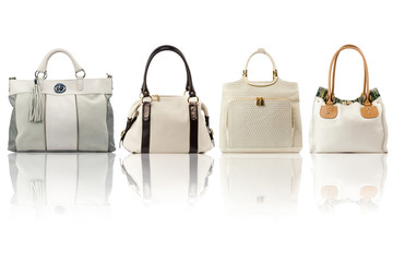 Beige handbags collection isolated on white background.Front view.