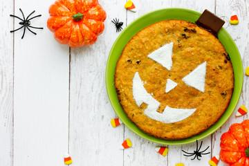 Homemade pumpkin pie for Halloween top view