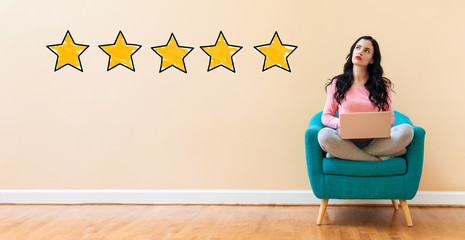 Five Star Rating with young woman using a laptop computer