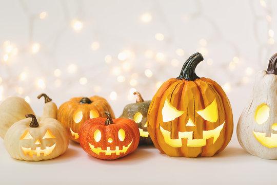 Halloween pumpkins on a shiny light background
