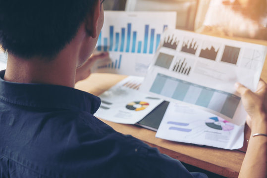 Businessman review paper, annual report, summary report, document,graph in office. Financial adviser plan and working. Business and financial report concept.