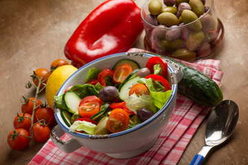 mixed salad with green olives capsicum cucumber and tomatoes
