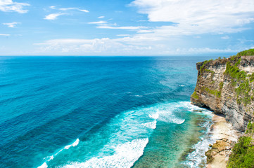 Landscape rocks sea cloudy blue sky Bali Indonesia