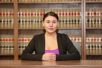 Young attractive woman lawyer in law office