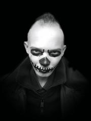 Halloween portrait of young man. Psycho. Horror clown.