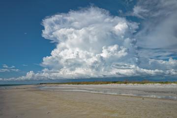 Cumulus cloud behind the beach