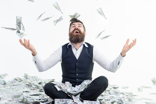 Businessman is happy with his money. Banknotes, cash dollars fly in air. Business success, richness&wealth concept. Very wealthy businessman. Happy businessman winner throws money banknotes. Dollars.