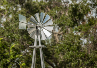 windmill weather vane helping to determine wind speeds and direction
