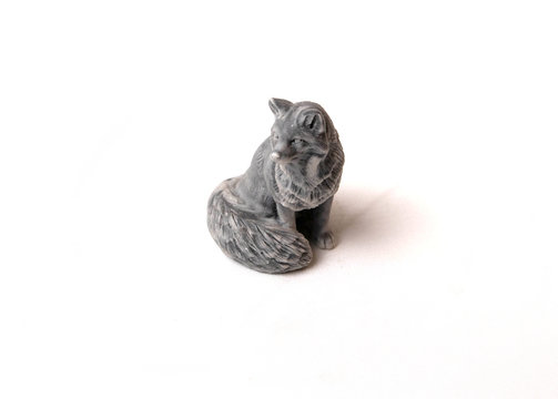 toy figurine of a marbled fox on a white background