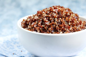Close up of Red quinoa cooked served in a bowl, selective focus