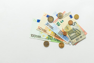 paper currency notes and coins euros, white background