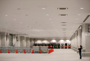 A woman takes photos at a facility of the new Tokyo Metropolitan Central Wholesale Market