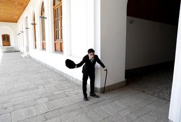 Afghanistan's Charlie Chaplin, Karim Asir, 25, exercises during his rehearsals in Kabul